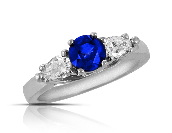 Sapphire and pear shape diamond ring in platinum.