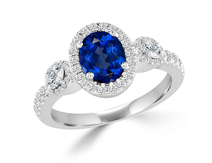 Sapphire and round brilliant cut and oval cut diamond ring in platinum.