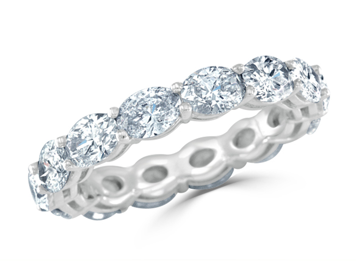Oval diamond band in platinum.
