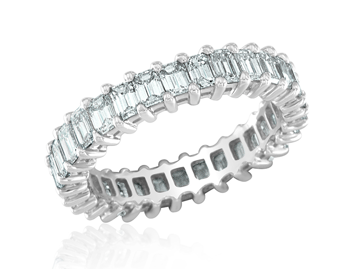 Emerald cut diamond band in platinum.