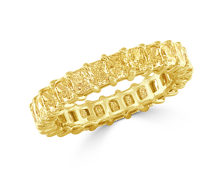 Radiant cut Fancy Yellow diamond band in 18k yellow gold.