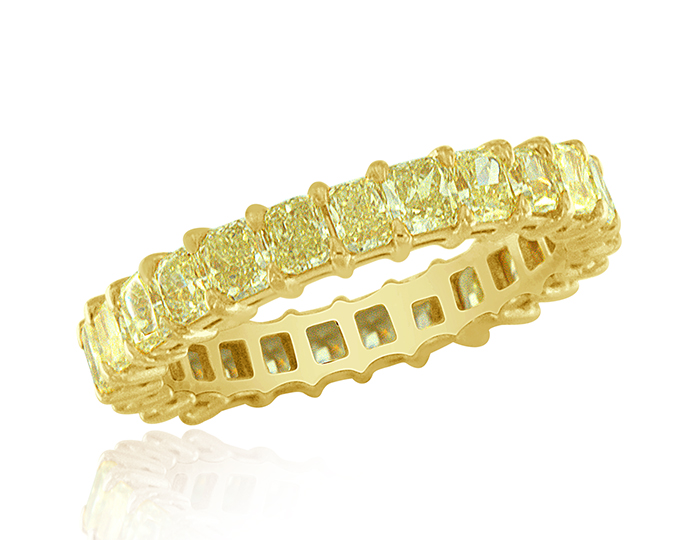 Radiant cut fancy intense yellow diamond band in 18k yellow gold.