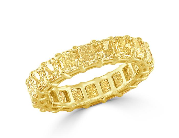 Radiant cut Fancy Yellow diamond band in 18k yellow gold.