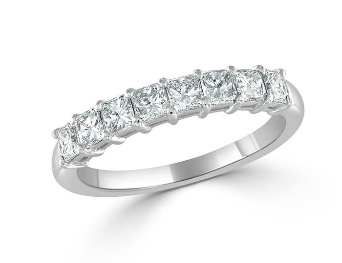 Radiant cut diamond band in platinum.