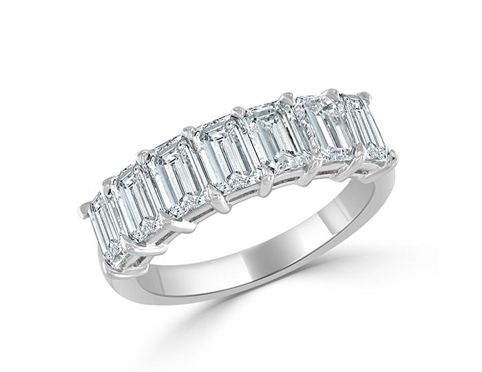 Emerald cut diamond band in platinum.