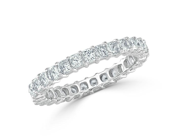 Cushion cut diamond band in platinum.