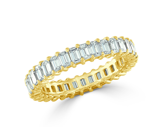 Emerald cut diamond band in 18k yellow gold.