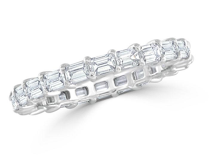 Emerald cut diamond eternity band in platinum.