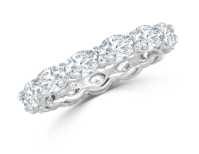 Oval shape diamond band in platinum.