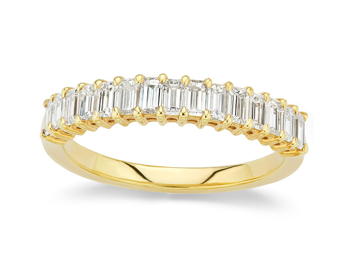Emerald cut diamond band in 18k yellow gold.
