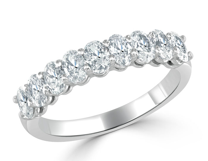 Oval cut diamond band in 18k white gold.