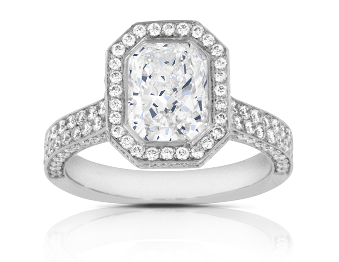 Radiant and round brilliant cut diamond engagement ring in platinum.