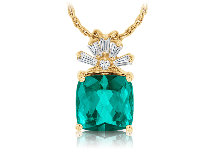 Green tourmaline and diamond pendant in 14k yellow gold.