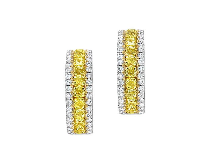 Round brilliant cut and yellow cushion cut diamond earrings in 18k white and yellow gold.