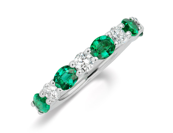 Oval emerald and round brilliant cut diamond ring 18k white gold.