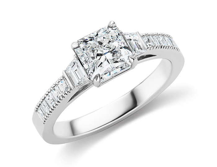 Radiant cut, trapezoid and blaze cut diamond engagement ring in 18k white gold.