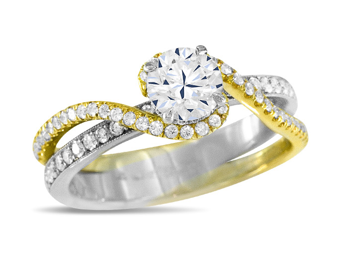 Round brilliant cut diamond engagement ring in 18k white and yellow gold.