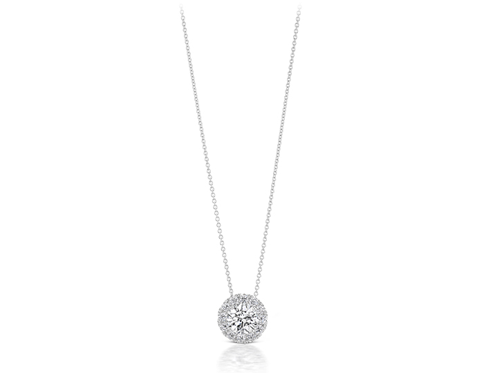Round brilliant cut diamond halo pendant in 18k white gold.