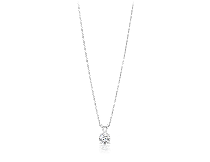 Round brilliant cut diamond solitaire pendant in 18k white gold.