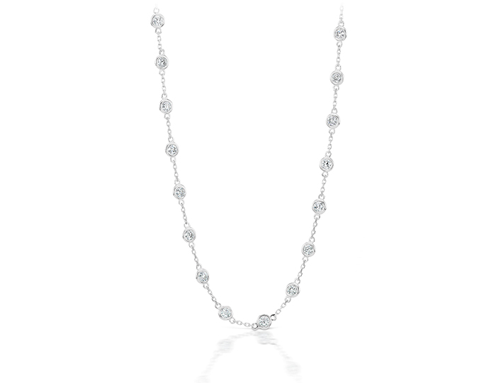 Round brilliant cut diamond bezel necklace in 18k white gold.                                                           In stock from $1,850 to $7,500.
