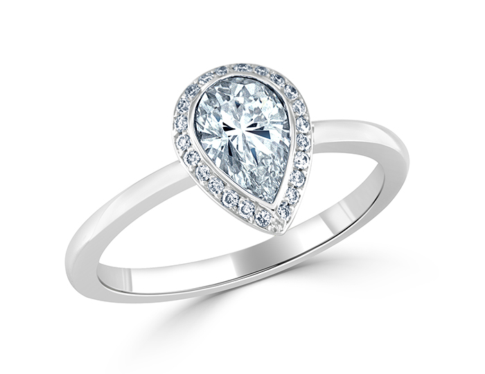 Pear shape center diamond and round brilliant cut diamond engagement ring in 18k white gold.
