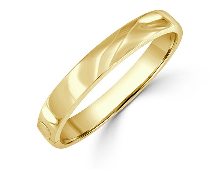 Bangle bracelet in 18k yellow gold.