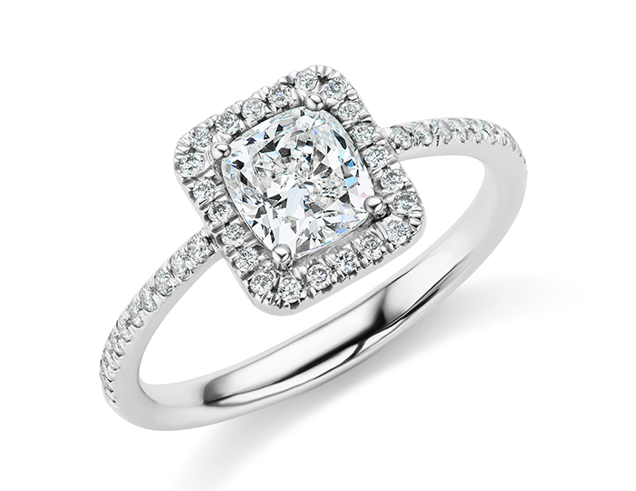 Cushion and round brilliant cut diamond engagement ring in 18k white gold.