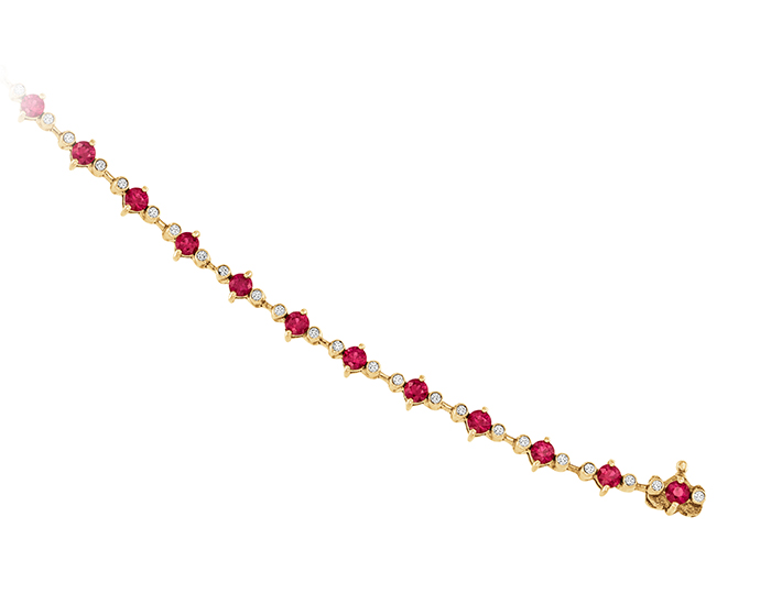Ruby and round brilliant cut diamond bracelet in 18k yellow gold.