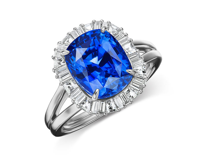 Sapphire ring with blaze and baguette cut diamonds in platinum.