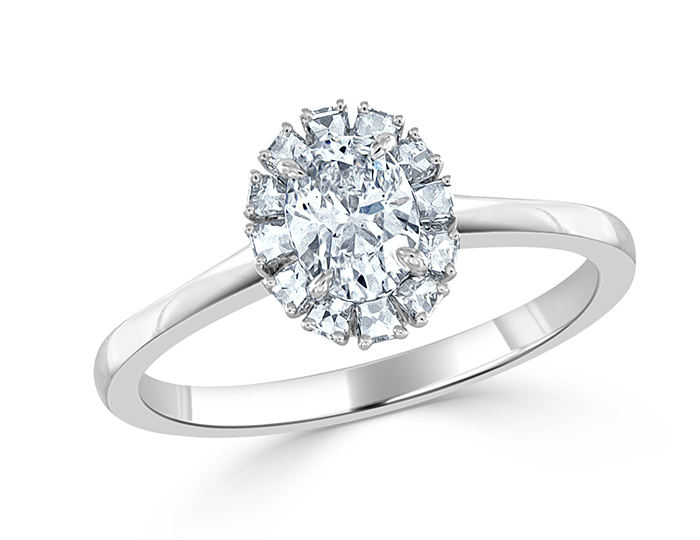 Oval and blaze cut diamond engagement ring in platinum.
