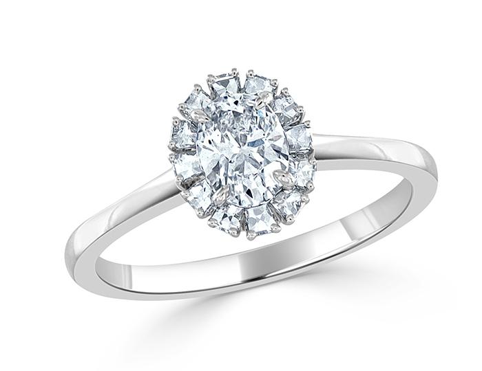 Bez Ambar oval and blaze cut diamond engagement ring in platinum.