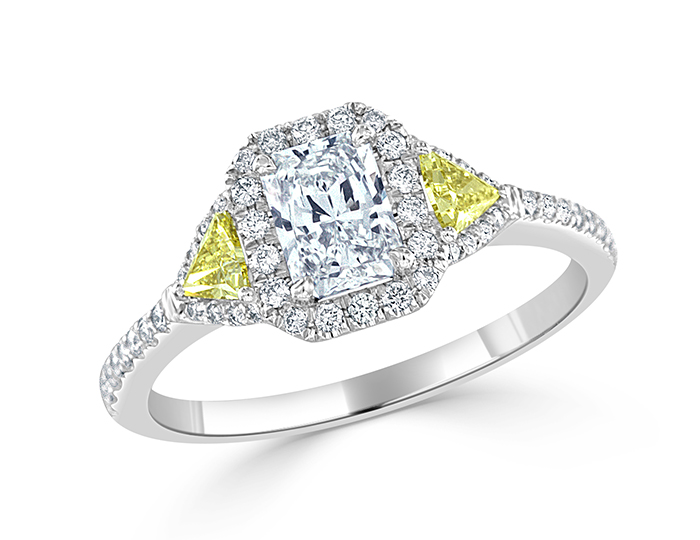 Radiant cut, intense fancy yellow trillion and round brilliant cut diamond engagement ring in platinum.