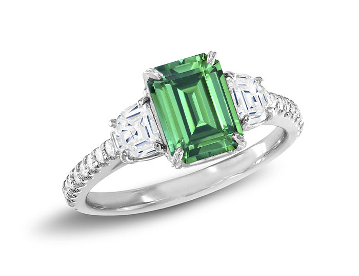 Bez Ambar emerald ring with half moon and round brilliant cut diamonds in platinum.