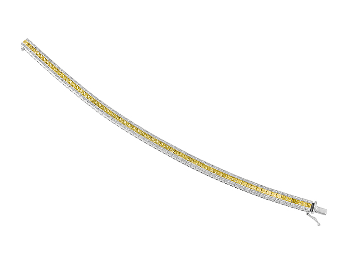 Round brilliant cut diamond and natural fancy yellow princess cut diamond bracelet in 18k white gold.