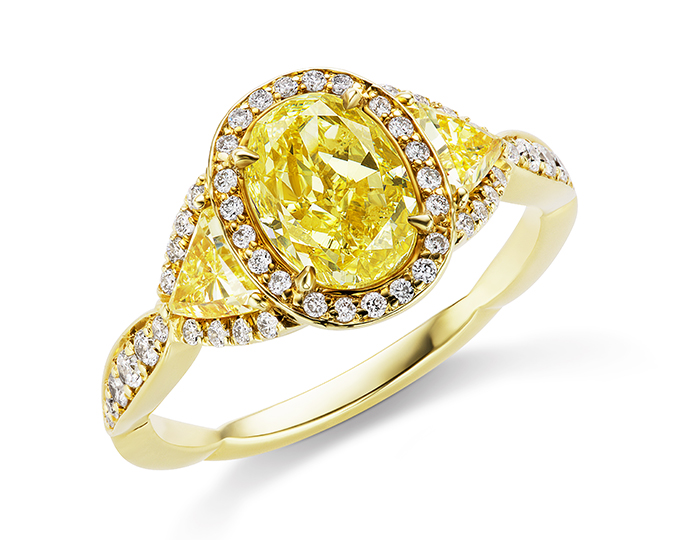 Oval and trillion fancy intense yellow and round brilliant cut diamond engagement ring in 18k yellow gold.