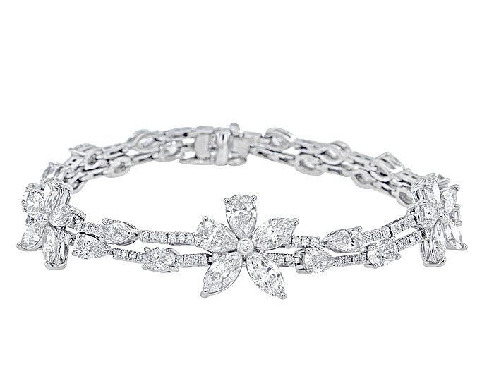 Marquise, pear, oval and round brilliant cut diamond bracelet in platinum.