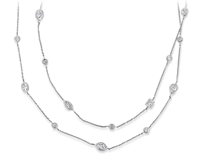 Mixed cut diamond bezel necklace in 18k white gold.