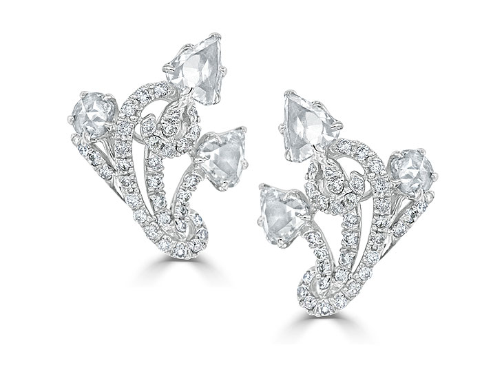 Rose cut and round brilliant cut diamond earrings in 18k white gold.