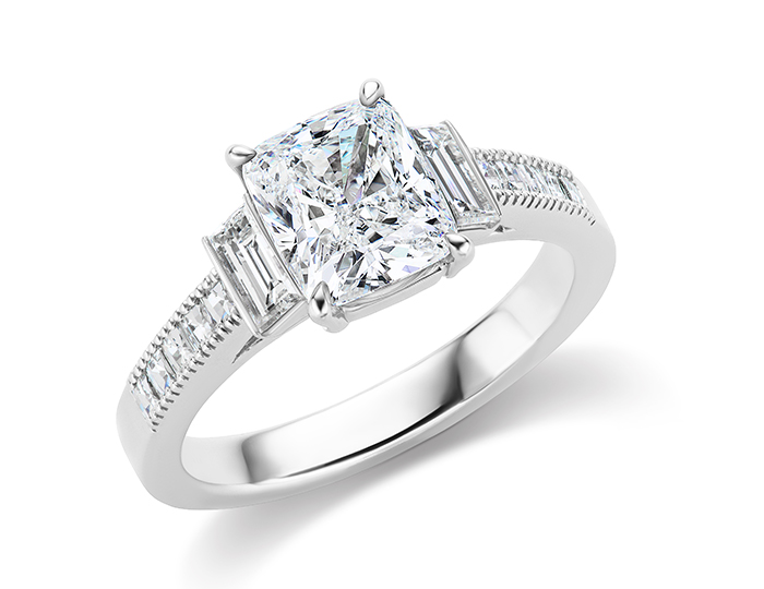 Cushion cut, baguette cut and blaze cut diamond engagement ring in platinum.