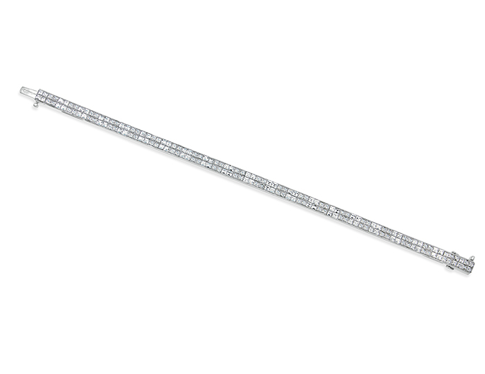 Blaze and princess cut diamond bracelet in 18k white gold.