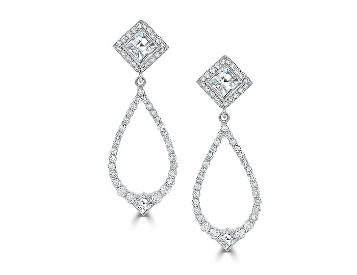 Blaze cut and round brilliant cut diamond earrings in 18k white gold.