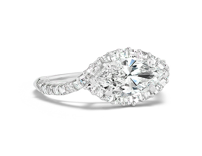 Marquise cut and blaze cut diamond engagement ring in platinum.