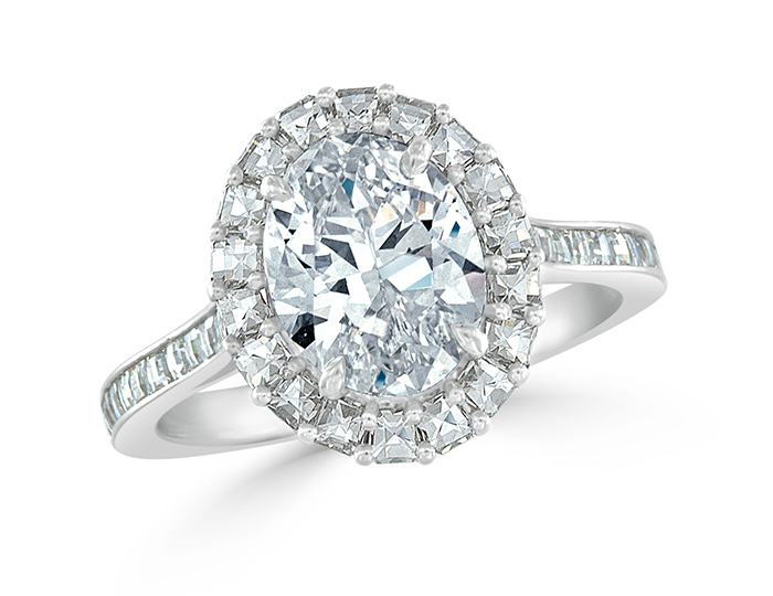 Oval cut and round brilliant cut diamond engagement ring in platinum.