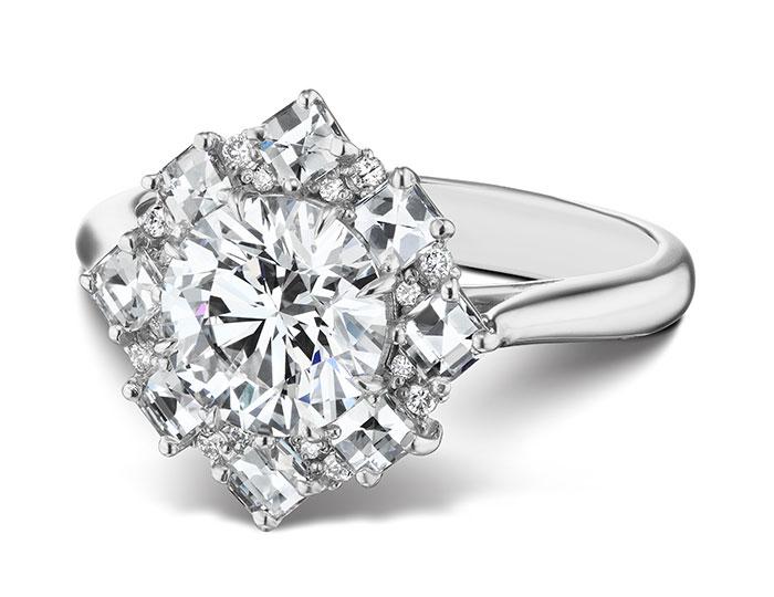 Bez Ambar round brilliant cut and blaze cut diamond engagement ring in platinum.