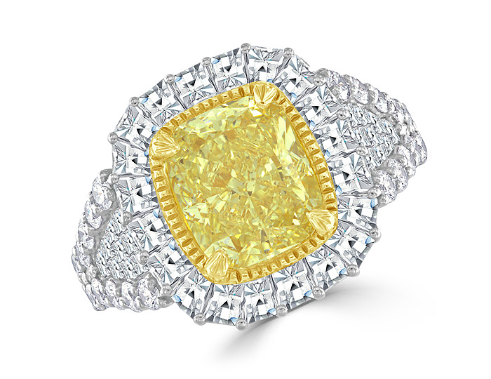 Bez Ambar cushion cut natural fancy yellow diamond with blaze cut and round brilliant cut diamond engagement ring.