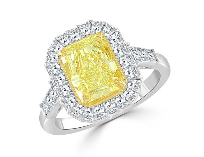 Bez Ambar fancy yellow radiant cut diamond and blaze cut diamond engagement ring in 18k yellow and white gold.