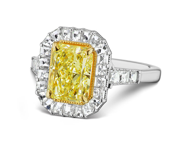 Bez Ambar fancy yellow radiant cut diamond and blaze cut diamond engagement ring in 18k yellow and white gold.