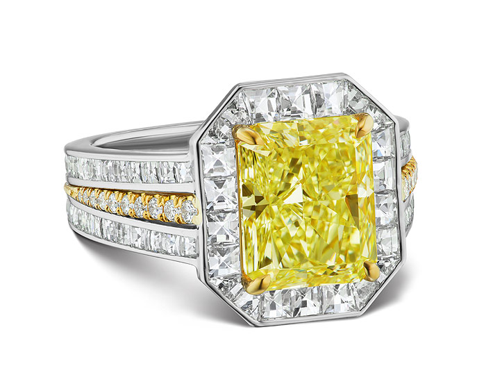 Bez Ambar radiant cut natural fancy yellow diamond with blaze cut and round brilliant cut diamond engagement ring in 18k white and yellow gold.