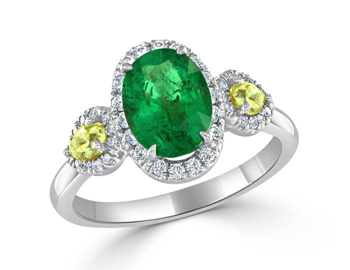 Oval shape emerald, pear shape yellow and round brilliant cut white diamond ring in 18k white gold and platinum.