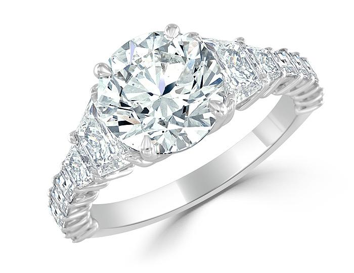 Bez Ambar round brilliant cut, trapezoid cut and blaze cut diamond engagement ring in platinum.